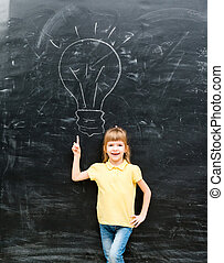 cute little boy with finger up having an idea