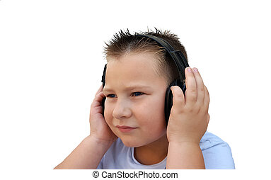 Cute little boy with in headphones listening to music