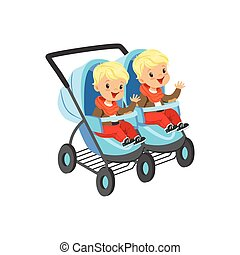 Cute little boys sitting in a blue baby carriage for twins,...