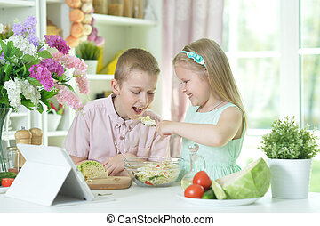 Cute little brother and sister cooking