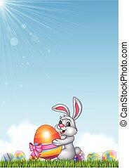 Cute little bunny holding easter egg