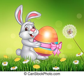 Cute little bunny holding Easter