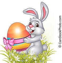 Cute little bunny holding eggs