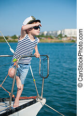cute little captain kid wearing captain hat and trendy...