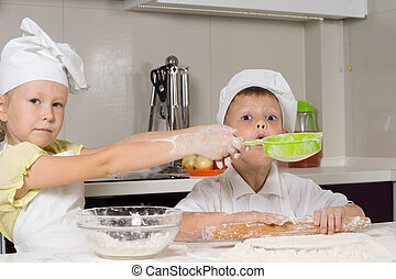 Cute Little Chefs Baking While Playing in Kitchen