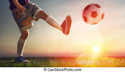 Child plays football