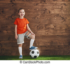 Girl plays football.