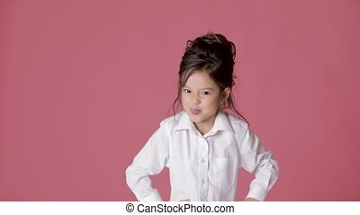 cute little child girl in white shirt shows different...