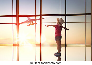 girl looks at a plane at the airport - Cute little child...