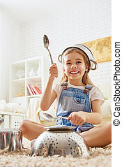 girl playing with utensils