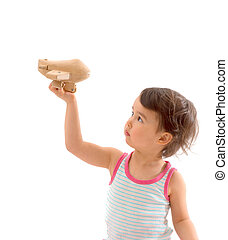Cute little child playing with a toy airplane. Isolated on white background