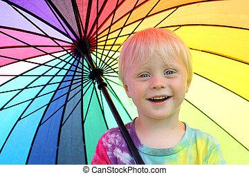 Cute Little Child Under Rainbow Colored Umbrella