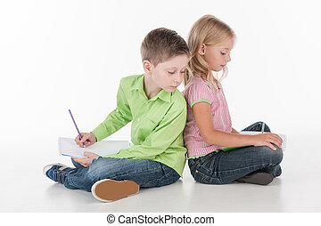 cute little children sitting on floor and drawing. small boy...