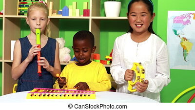 Cute little class making music together in playschool