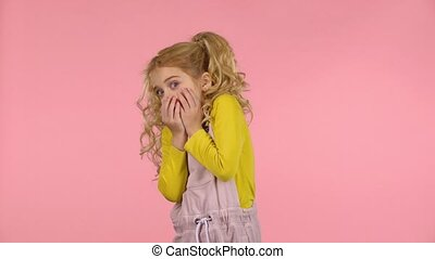 Cute little female is scared and hiding her face - Cute...