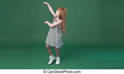 Cute little ginger girl dancing and fooling around, chroma...