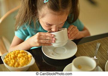 little girl at breakfast