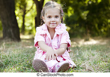 Cute little girl at outdoor in fall.