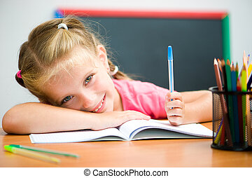 cute little girl at the desk