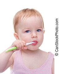 cute, little girl brushing her teeth