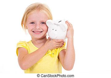 cute little girl carrying piggybank
