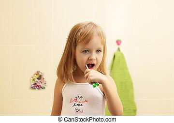 cute little girl clean teeth - happy little girl clean teeth...