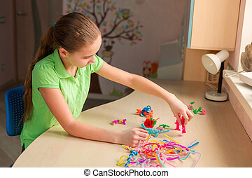 Cute little girl creating toys with chenille sticks