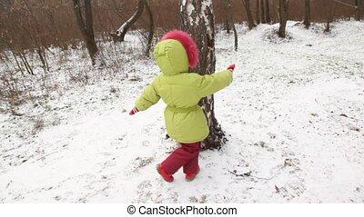 Cute little girl dances round tree. - Cute little girl...