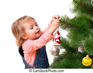 Cute little girl decorates the Christmas tree. Isolated on white