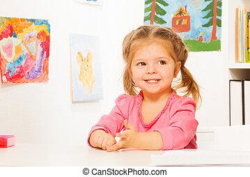 Cute little girl doing her lessons at the desk - Little...