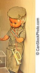 Cute little girl doll, in soldier uniform