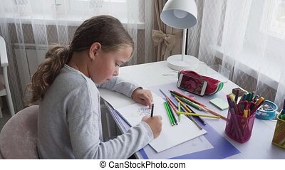 Cute little girl drawing flower off smartphone screen at...