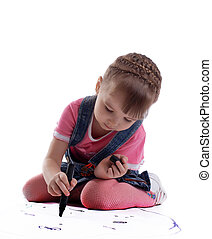 Cute little girl drawing on floor