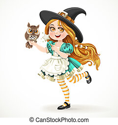 Cute little girl dressed as witch with a owl and magic wand standing on a white background