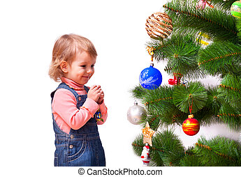 Cute little girl dressing the Christmas tree. Isolated on white