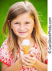 Cute little girl eating ice cream - Happy cute little girl...