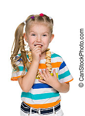 Cute little girl eats bagels