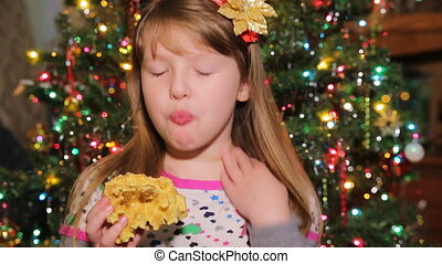 cute little girl eats cake sakotis new year and merry christmas background