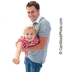 Cute little girl enjoying piggyback ride with her father