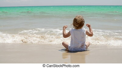 Cute little girl enjoying the sea