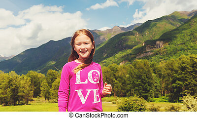 Cute little girl hiking in swiss Alps. Image taken in Simplon pass, border between Switzerland and Italy