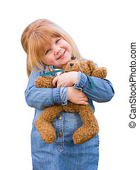 Cute Little Girl Holding Her Teddy Bear On White