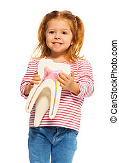 Cute little girl holding tooth model in her hands