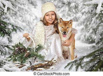 Cute little girl hugging a dog