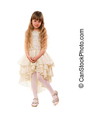 Cute little girl in a beige dress