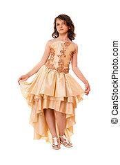 Cute little girl in a chic dress