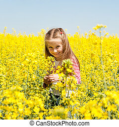 cute little girl in a field