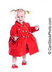 Cute little girl in a red dress. In the studio. Isolated