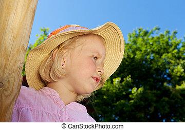Cute little girl in a straw hat