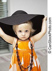 cute little girl in black hat
